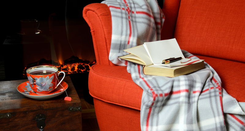Chair, fireplace, book, blanket